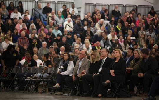 Hundreds of people attend a vigil on Sunday at the News-Sun Center in Sebring, Florida, for the five people that were killed in a shooting at a SunTrust Bank on Jan. 23 in Sebring.