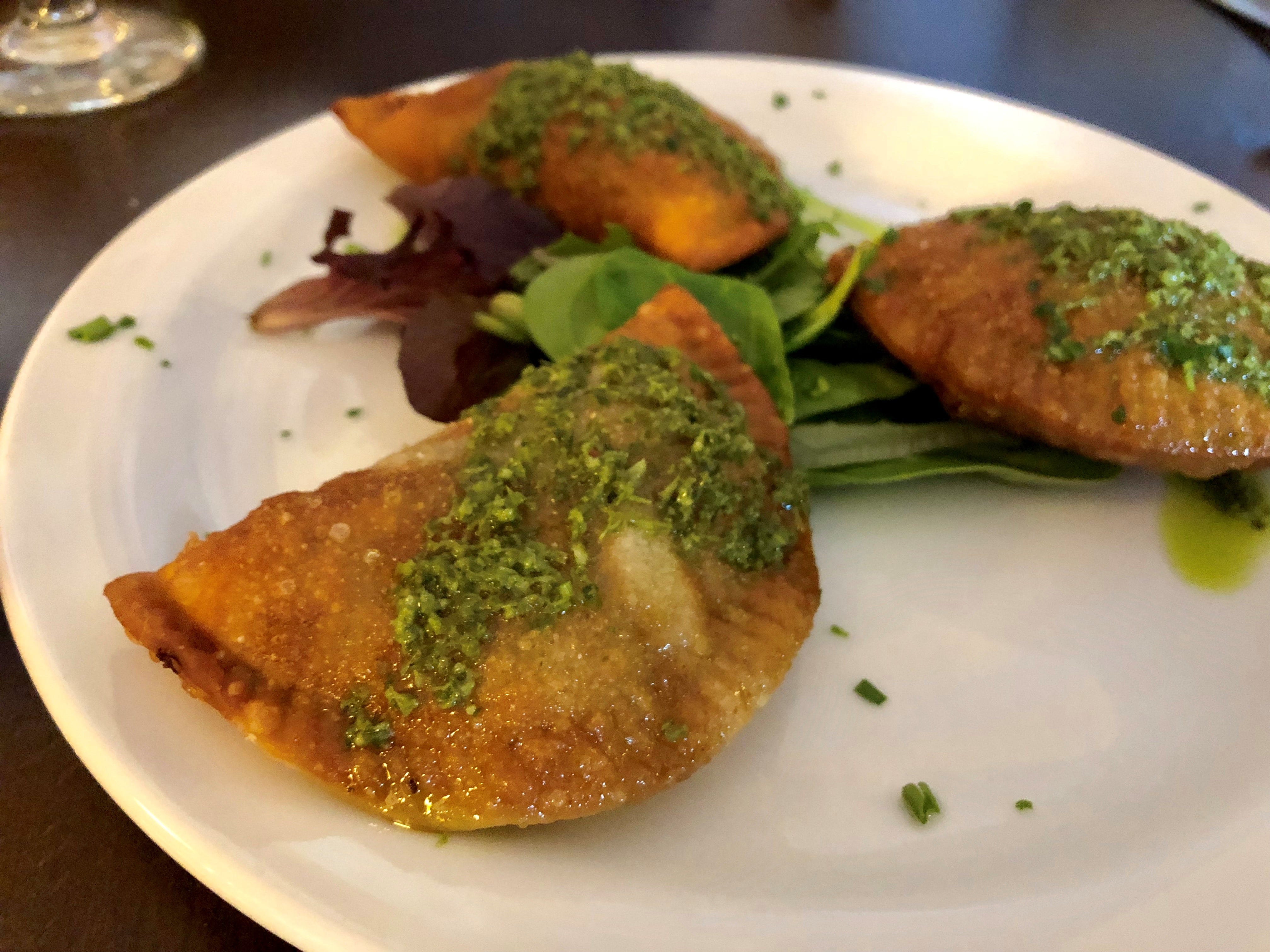 Empanadas are stuffed with chicken and drizzled in salsa verde at La Trattoria Cafe Napoli in south Fort Myers.