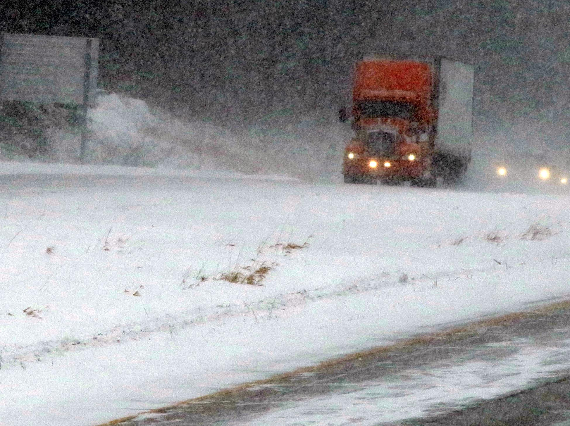 Traffic goes northbound on Interstate 43, south of the state Highway 42 exit, Monday, Jan. 28, 2019, in Sheboygan, Wis. According to Sheboygan County Sheriff Cory Roesler, due to the many closures of businesses and schools, incidents have been kept to a minimum.