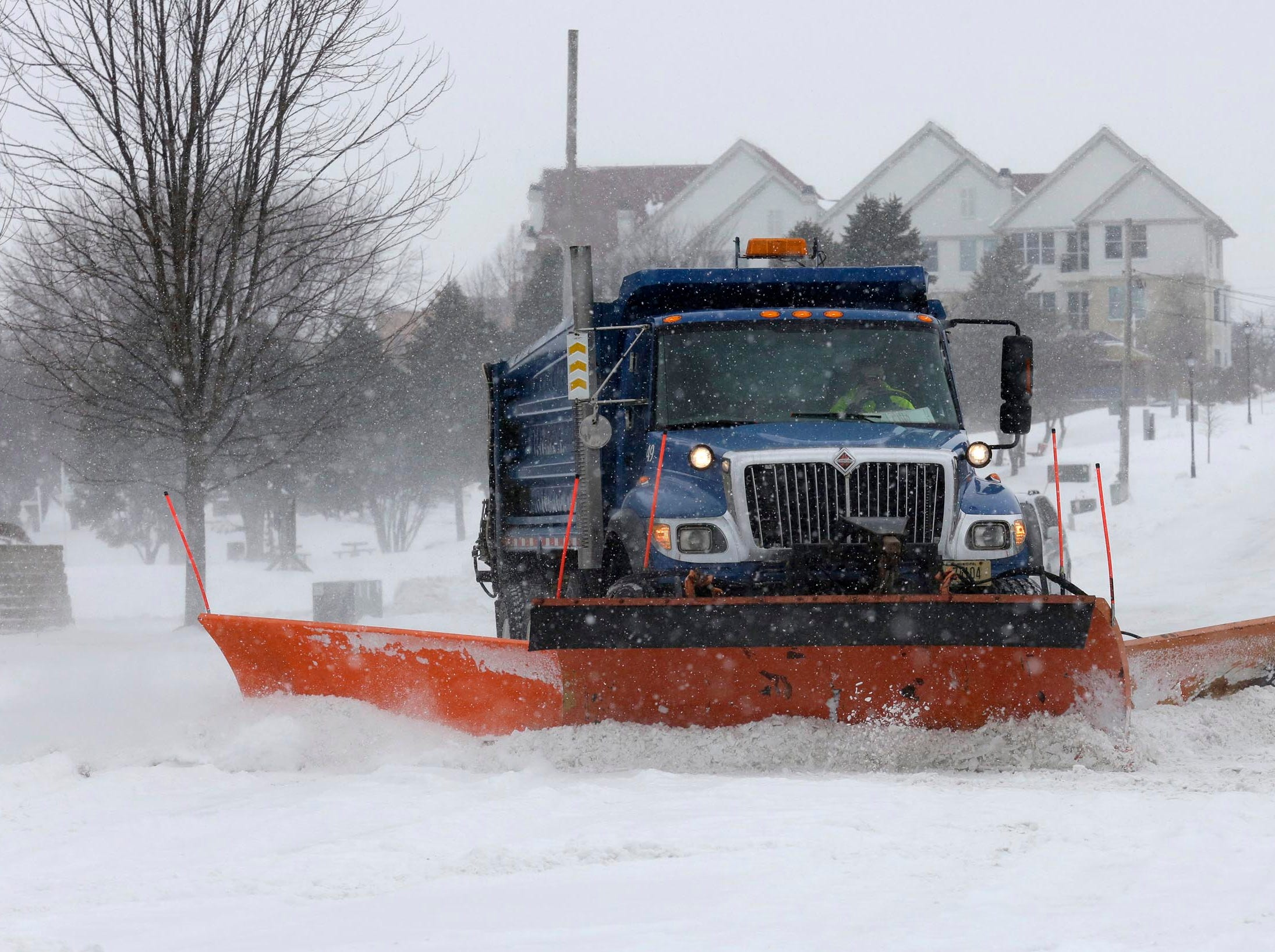 A City of Sheboygan snow plow corners on to Broughton Drive off Pennsylvania Avenue, clearing the path for motorists, Monday, Jan. 28, 2019, in Sheboygan, Wis.