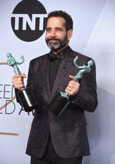 "Tony Shalhoub poses in the press room with awards for Outstanding Performance by a Male Actor in a Comedy Series and Outstanding Performance by an Ensemble in a Comedy Series in ""The Marvelous Mrs. Maisel"" during the 25th Annual Screen Actors Guild Awards on Sunday."