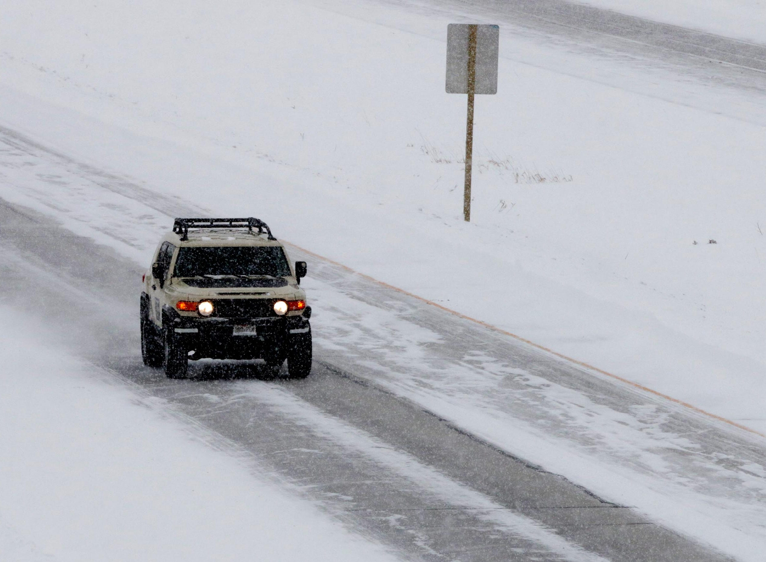 An all-wheel drive vehicle motors southbound on Interstate 43, south of the state Highway 42 exit, Monday, Jan. 28, 2019, in Sheboygan, Wis. According to Sheboygan County Sheriff Cory Roesler, due to the many closures of businesses and schools, incidents have been kept to a minimum.