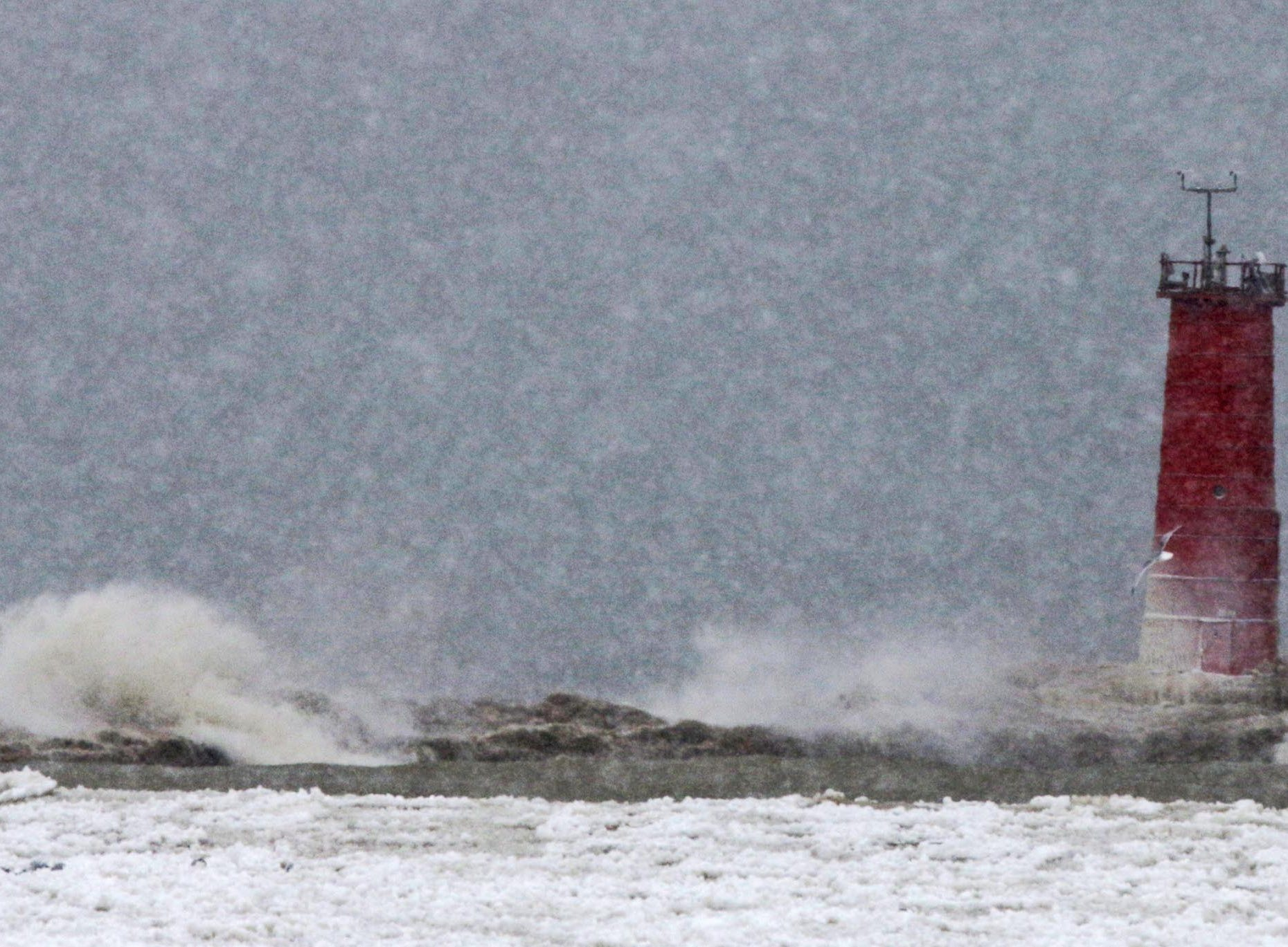 Waves bash against the breakwater by the Sheboygan lighthouse, Monday, Jan. 28, 2019, in Sheboygan, Wis. Winter weather in the area also has brought rough water on the lake.