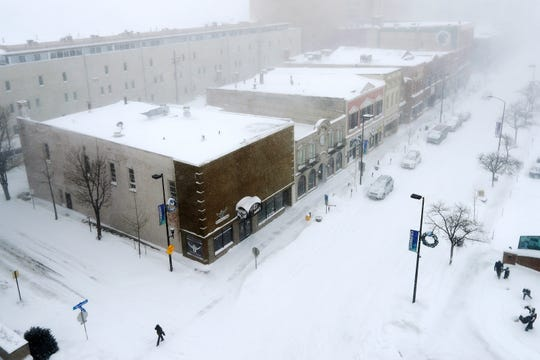 Washington St. is shown during a snowstorm on Monday, Jan. 28, 2019 in Green Bay, Wis.