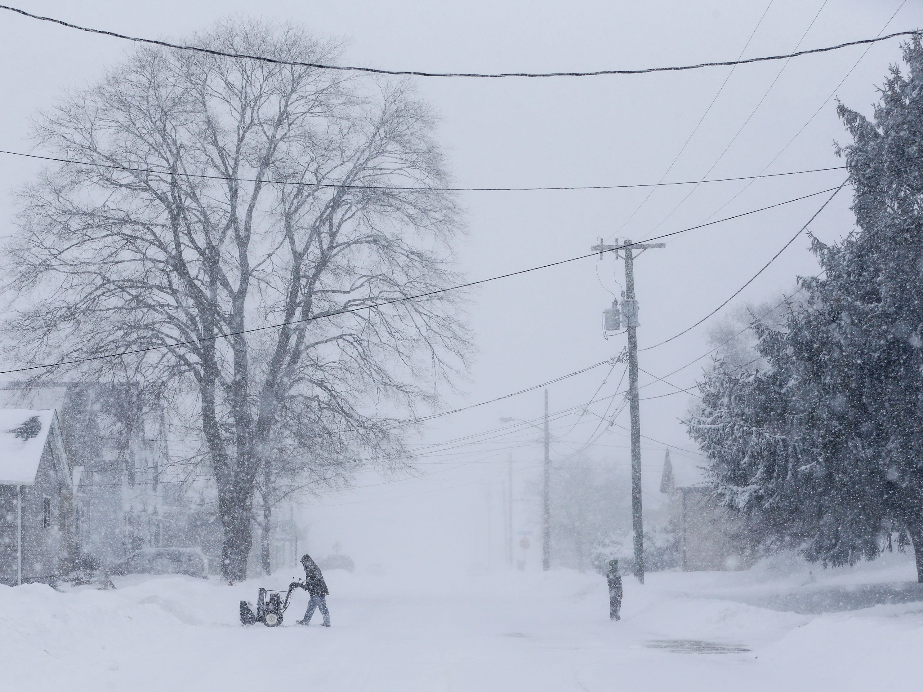 A view of the 1000 block of 13th Street as a snowstorm moves across the state Monday, Jan. 28, 2019, in Manitowoc, Wis.