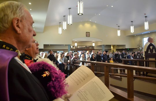 Members of the Knights of Columbus are seen at left with the sanctuary of the new Holy Trinity Catholic Church in the background at the dedication service on Jan. 27.