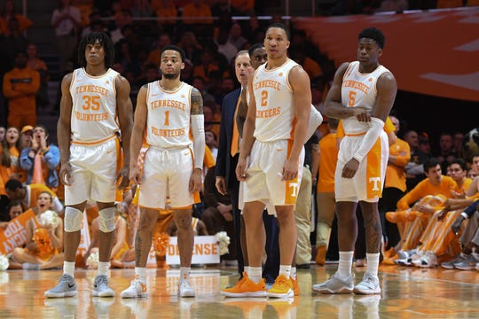 Tennessee Volunteers forward Yves Pons (35) and guard Lamonte Turner (1) and head coach Rick Barnes and guard Jordan Bone (0) and forward Grant Williams (2) and guard Admiral Schofield (5) during the second half against the West Virginia Mountaineers at Thompson-Boling Arena in Knoxville, Tenn.
