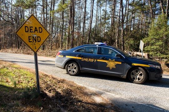 A Greenville County Sheriff's deputy is stationed near the location where a man's body was found by utility workers on Monday, Jan. 28, 2019.