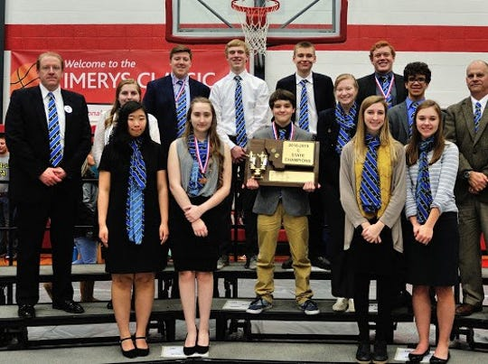 The 2018-2019 Montana State B-C Speech, Debate, & Drama Tournament champs from Great Falls Central Catholic High School are (back row, l-r): Avery Holden, Colby Aderhold, Kade Belderrain, Quin Pray; (Middle row) Coach Jason Holden, Trinity Holden, Noah Schmit, Jess Walker, Sterling Chargois, Coach Judge John Kutzman; (front row) Bing Hu, Theresa Voeller, Ella Walters, Alexis Wigdorski.