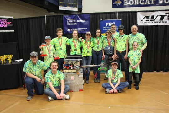 RedNek Robotics of the Sun River Valley celebrates winning state. Members include Devon Lindquist, Aaron Brubaker both graduated but still ReDNeKs, Luke Ostberg, Kenna Brooks and behind them Carsten Brooks, Xander Digan, Adeline Hahn, Brittney McNair, Mandy Widmer, Tyler McNair, Roger Lindquist, Jack Knight III and coach Chuck Merja.