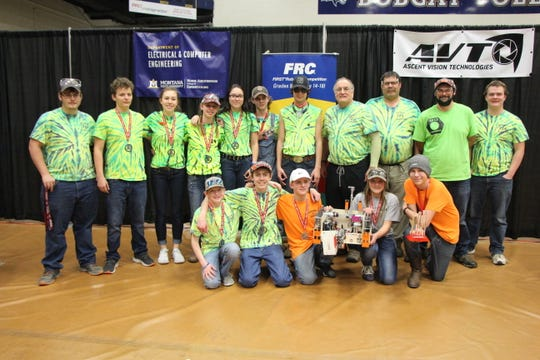 Sun River Robotics 8th grade team celebrates finishing the state competition as part of the runner-up alliance. Members include (front) Carsten Brooks, Luke Ostberg, Marshall Kunkel, Halee Hane, Andrew Hansen and behind them Devon Lindquist, Xander Digan, Adeline Hahn, Brittney McNair, Mandy Widmer, Tyler McNair, Jack Knight III, Chuck Merja, Roger Lindquist, Tyler Bennett (former member, now coach for another team) and Aaron Brubaker.