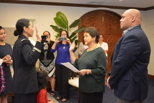 Gov. Lou Leon Guerrero swears in Lt. Col. Esther Aguigui as her new appointment to lead the Guam National Guard.