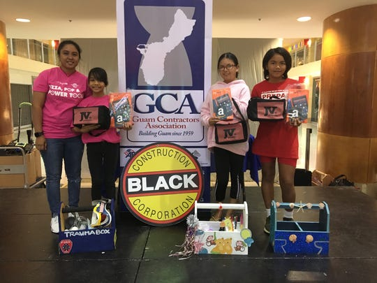 "Nikolette Salas, a sixth grade student at Untalan Middle School, (second from the left) won first place (a 10-inch Amazon Fire tablet, $100 Amazon gift certificate and a J.V. International gift bag) at the Guam Contractors Association annual Pizza, Pop and Power Tools ""Tool Box Project Competition"" event sponsored by Black Construction Corp., at the Agana Shopping Center on Jan. 27."