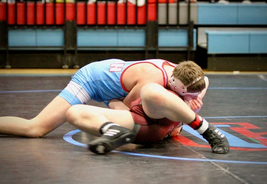 Wrestler Payton Ervin makes a pin for Union County at the Jan. 19 duals at UCHS.