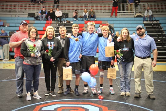 Seniors Sam Bacon, Ryan Heidrich and Payton Ervin along with their families were honored at the Bryce Sheffer Memorial Duals.