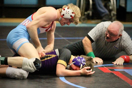 UCHS Brave Sam Bacon tries to flip his opponent for a pin at the Bryce Sheffer Memorial Duals on Jan. 19. Bacon had been sidelined by an injury weeks prior to the duals.