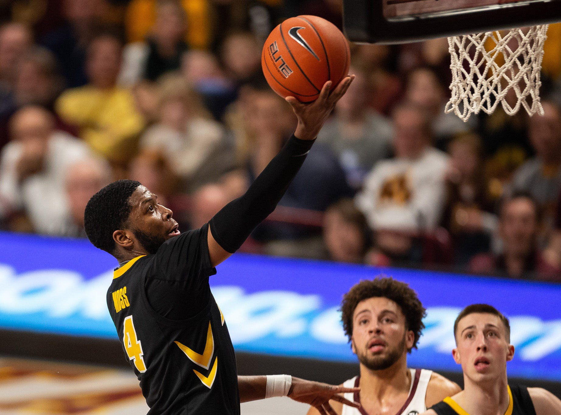 Iowa Hawkeyes guard Isaiah Moss (4) shoots the ball during the second half against the Minnesota Gophers at Williams Arena. Mandatory Credit: Harrison Barden-USA TODAY Sports