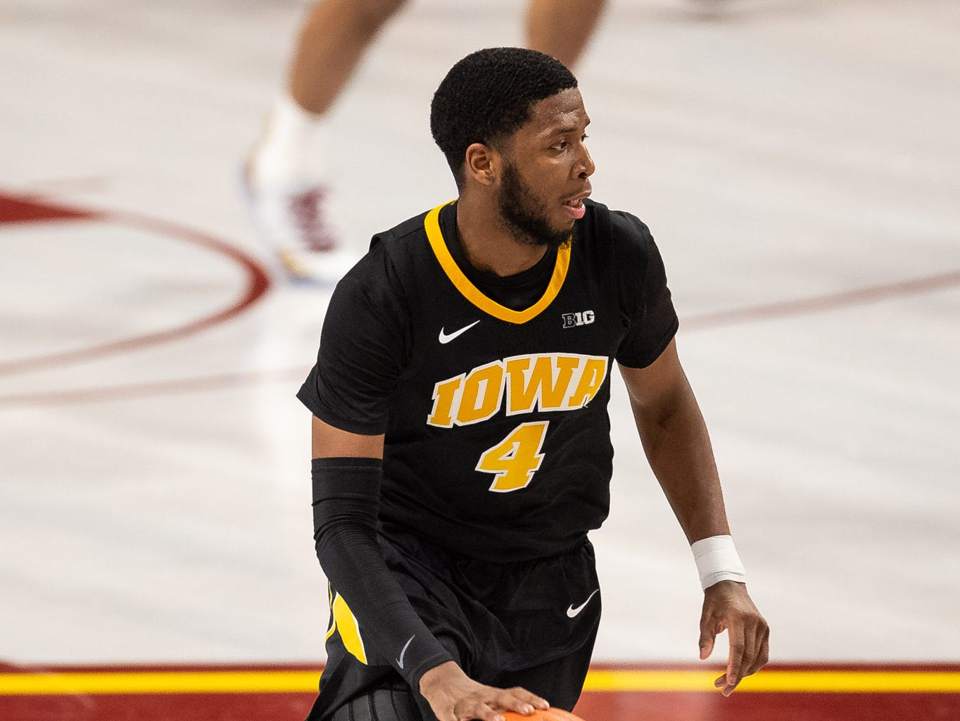 Iowa Hawkeyes guard Isaiah Moss (4) dribbles the ball during the second half against the Minnesota Gophers at Williams Arena. Mandatory Credit: Harrison Barden-USA TODAY Sports