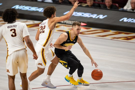 Iowa point guard Jordan Bohannon did more dribbling than shooting in Sunday's loss at Minnesota. He knows he needs to get more aggressive about finding his offense with No. 5 Michigan coming to town Friday.