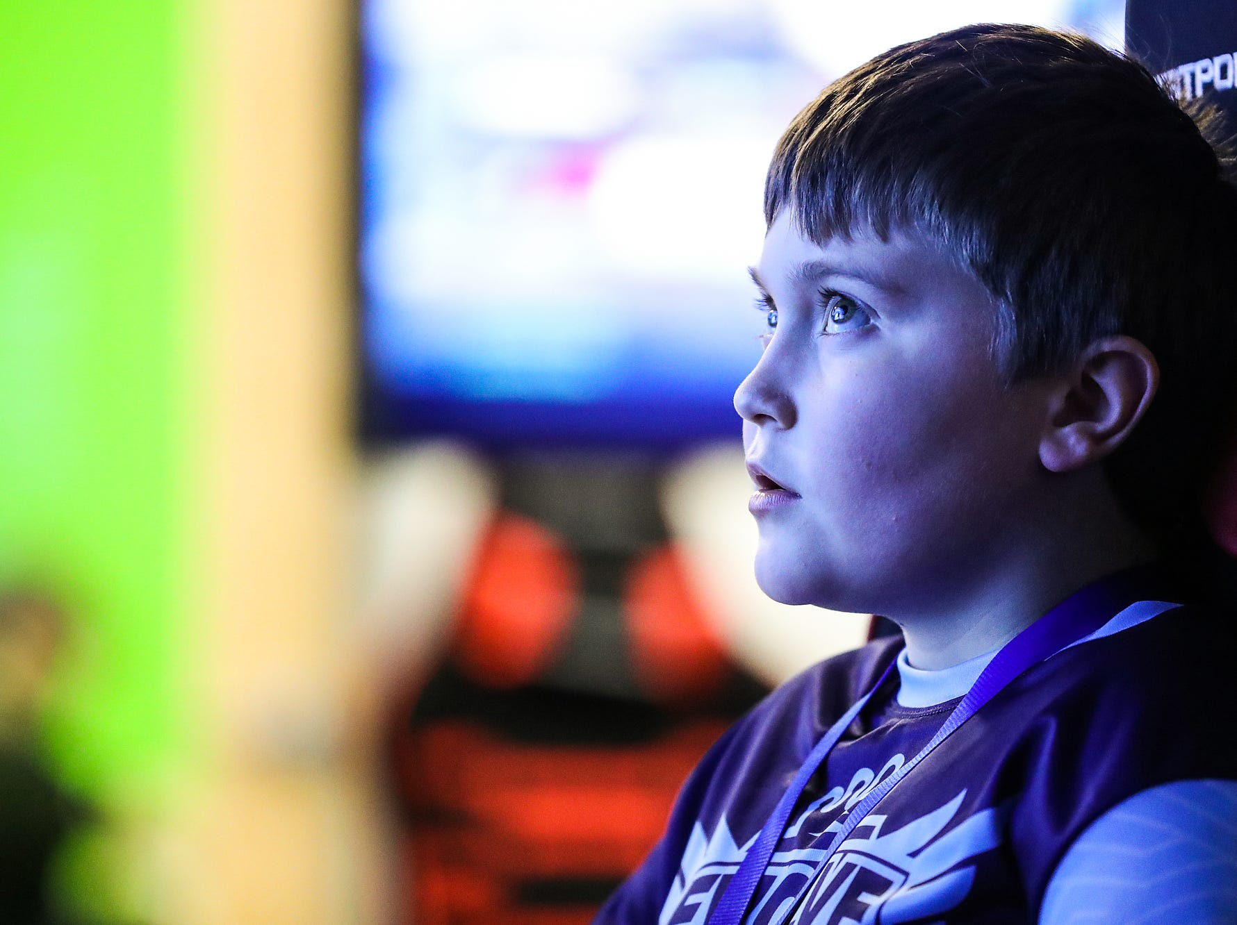Parker Suter, 11, competes with teammates in a video game at an Evolve Youth Sports practice at the Player One arena in Carmel, Ind., Thursday, Jan. 24, 2019. Scott Wise, original founder of Scotty's Brewhouse, has partnered with Player One Esports for his next venture, a video game sports league that has attracted around 200 kids so far.