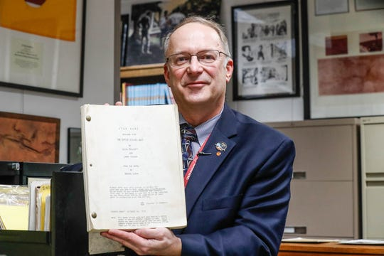 "Jon Eller, director of the Center for Ray Ray Bradbury Studies, holds an original Star Wars script of ""The Empire Strikes Back"" by Leigh Brackett and Larry Kasdan. It's inside the Center for Ray Bradbury Studies located at Cavanaugh Hall at IUPUI."