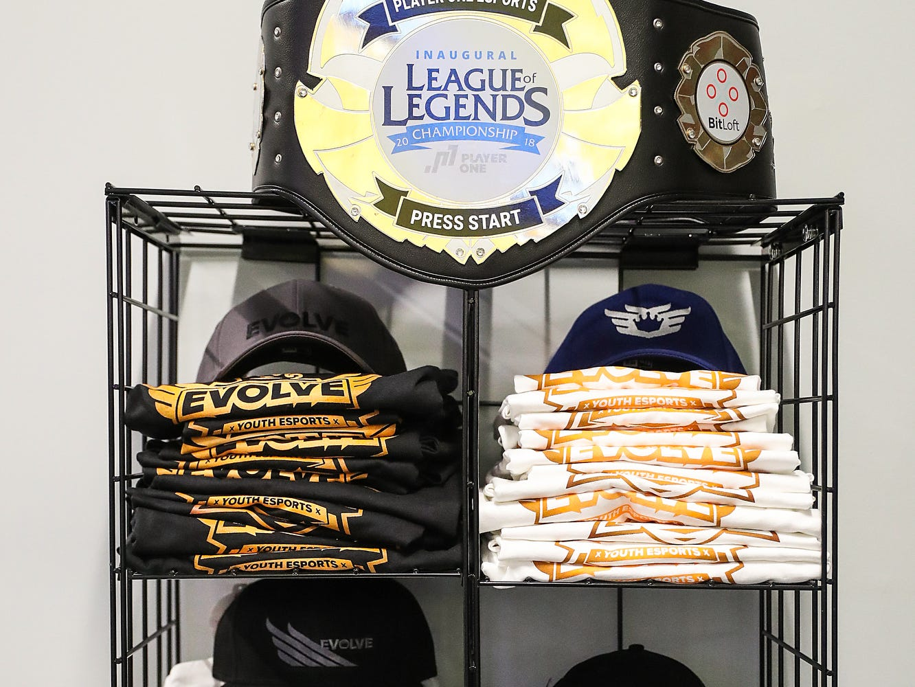 Merchandise is on display near the front entrance at the Player One arena in Carmel, Ind., seen during an Evolve Youth Sports practice, Thursday, Jan. 24, 2019. Scott Wise, original founder of Scotty's Brewhouse, has partnered with Player One Esports for his next venture, a video game sports league that has attracted around 200 kids so far.