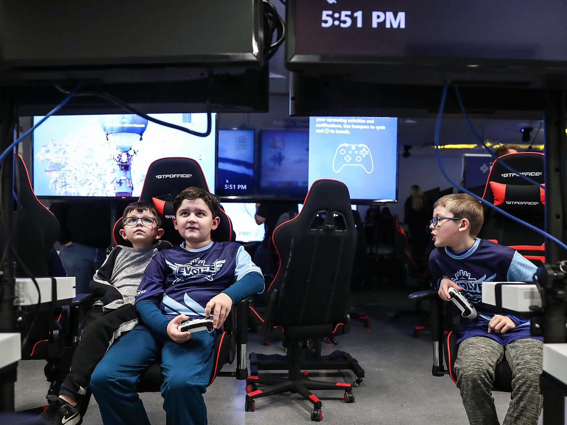 Kids participate in an Evolve Youth Esports practice at the Player One arena in Carmel, Ind., Thursday, Jan. 24, 2019. Under the supervision of professional esports coaches, members will practice and compete in football, basketball and soccerÊvideo games.