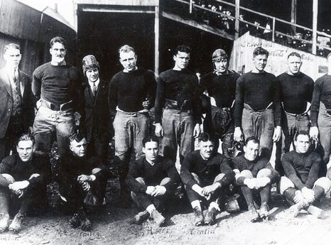 In 1920, a series of meetings resulted in the creation of the American Professional Football Association (APFA). The league consisted of 14 teams, with the Decatur Staleys (now Chicago Bears) and Chicago Cardinals (now Arizona Cardinals) the only two teams still remaining. The 1920 inaugural season did not maintain official standings, but the Akron Pros were awarded the APFA championship by virtue of their 8-0-3 record. In 1922, the APFA changed its name to the National Football League (NFL). (pictured: Akron Pros, 1920)