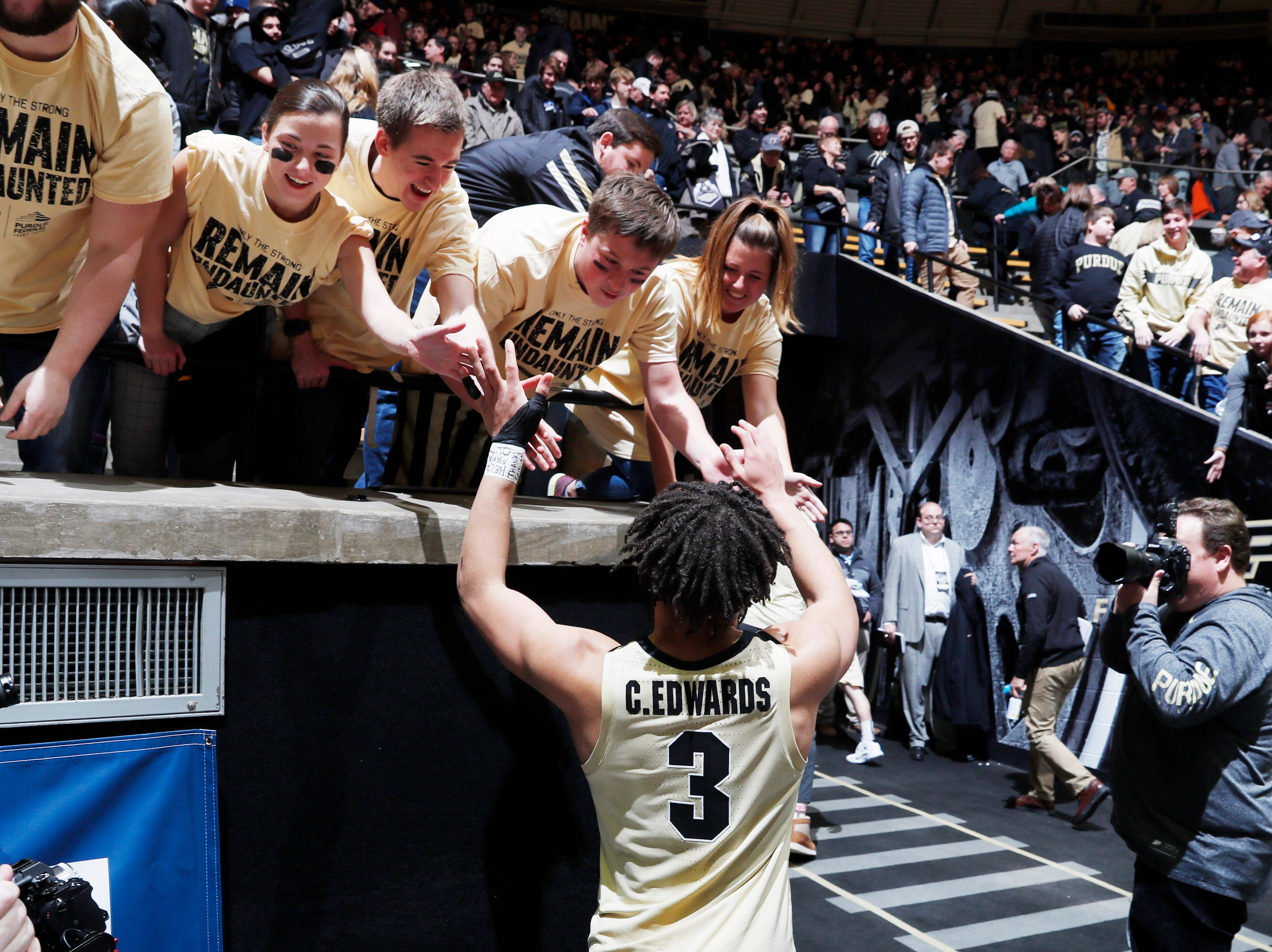 Purdue Boilermakers guard Carsen Edwards (3) celebrates with fans in the stands after defeating the Michigan State Spartans at Mackey Arena.