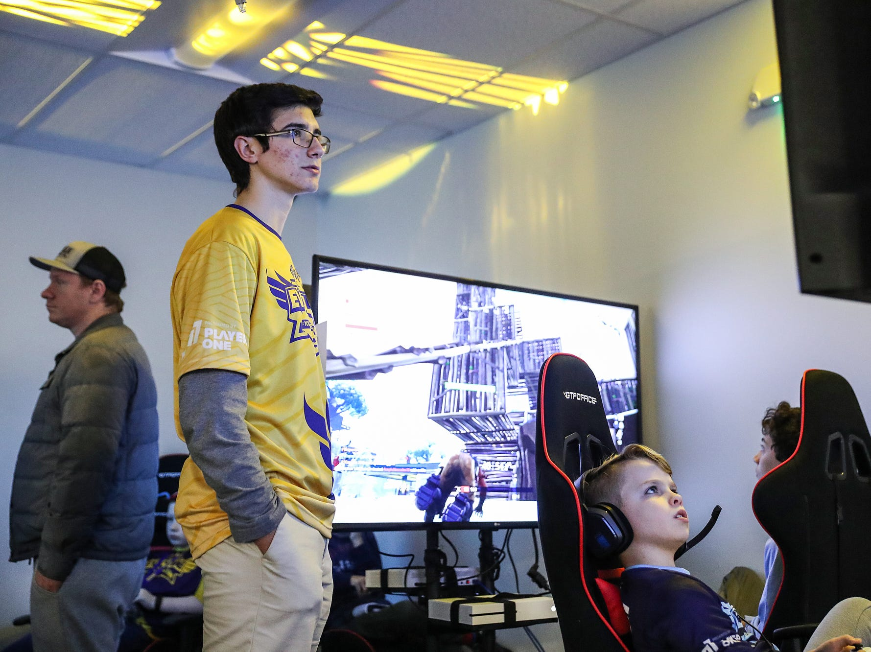 At left, coach Ignacio Salusso, 17, oversees team play during an Evolve Youth Sports practice at the Player One arena in Carmel, Ind., Thursday, Jan. 24, 2019. Scott Wise, original founder of Scotty's Brewhouse, has partnered with Player One Esports for his next venture, a video game sports league that has attracted around 200 kids so far.