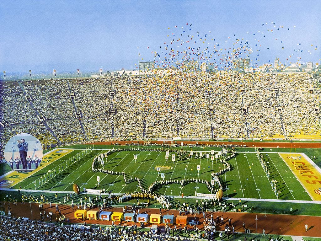 On January 15, 1967 the champions of the AFL (Kansas City) and NFL (Green Bay) went head-to-head in the first Super Bowl. The game was held at the Los Angeles Coliseum and despite tickets selling for about $12, this was the only Super Bowl that didn't sell out. The Green Bay Packers defeated the Kansas City Chiefs 35-10.