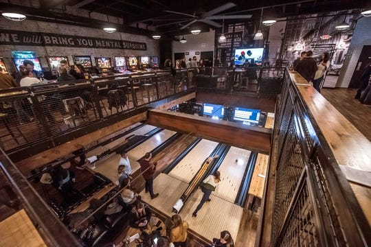 Pins Mechanical duckpin bowling alley in Cincinnati, pictured here, has cocktails and old-school games like foosball, pinball, ping-pong and bocce ball.