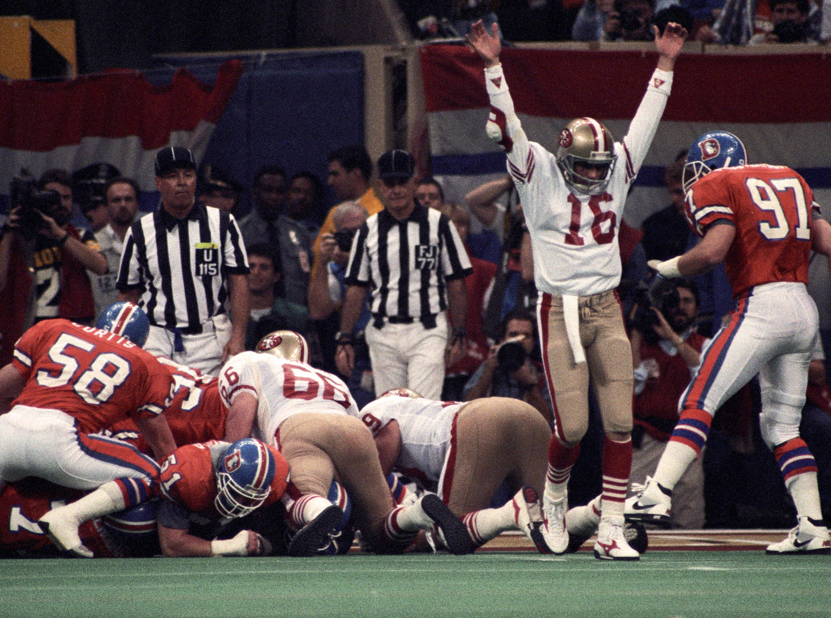The second NFL dynasty was the San Francisco 49ers. They won five Super Bowl championships between 1981 and 1995 with Hall of Famers Joe Montana, Jerry Rice, Ronnie Lott, Steve Young and head coach Bill Walsh. The 1989 team is considered one of the most dominant teams in NFL history, with the most points scored and widest margin of victory in a Super Bowl (55-10) and winning three playoff games by a combined 100 points. (pictured: Jan 28, 1990; New Orleans, LA, USA; San Francisco 49ers quarterback Joe Montana (16) reacts on the field against the Denver Broncos during Super Bowl XXIV at the Superdome.)