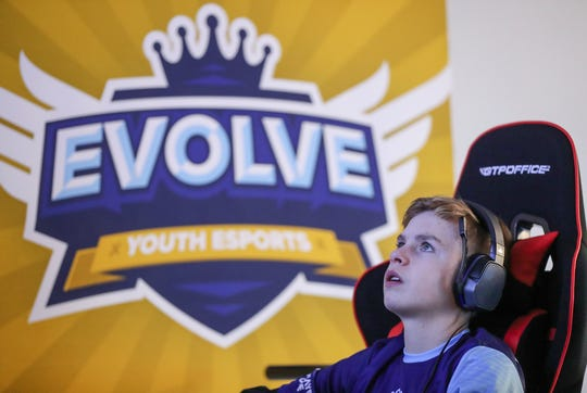 Brandon Woodard, 14, competes in a video game during an Evolve Youth Sports practice at the Player One arena in Carmel, Ind., Thursday, Jan. 24, 2019. Under the supervision of professional esports coaches, members will practice and compete in football, basketball and soccerÊvideo games.