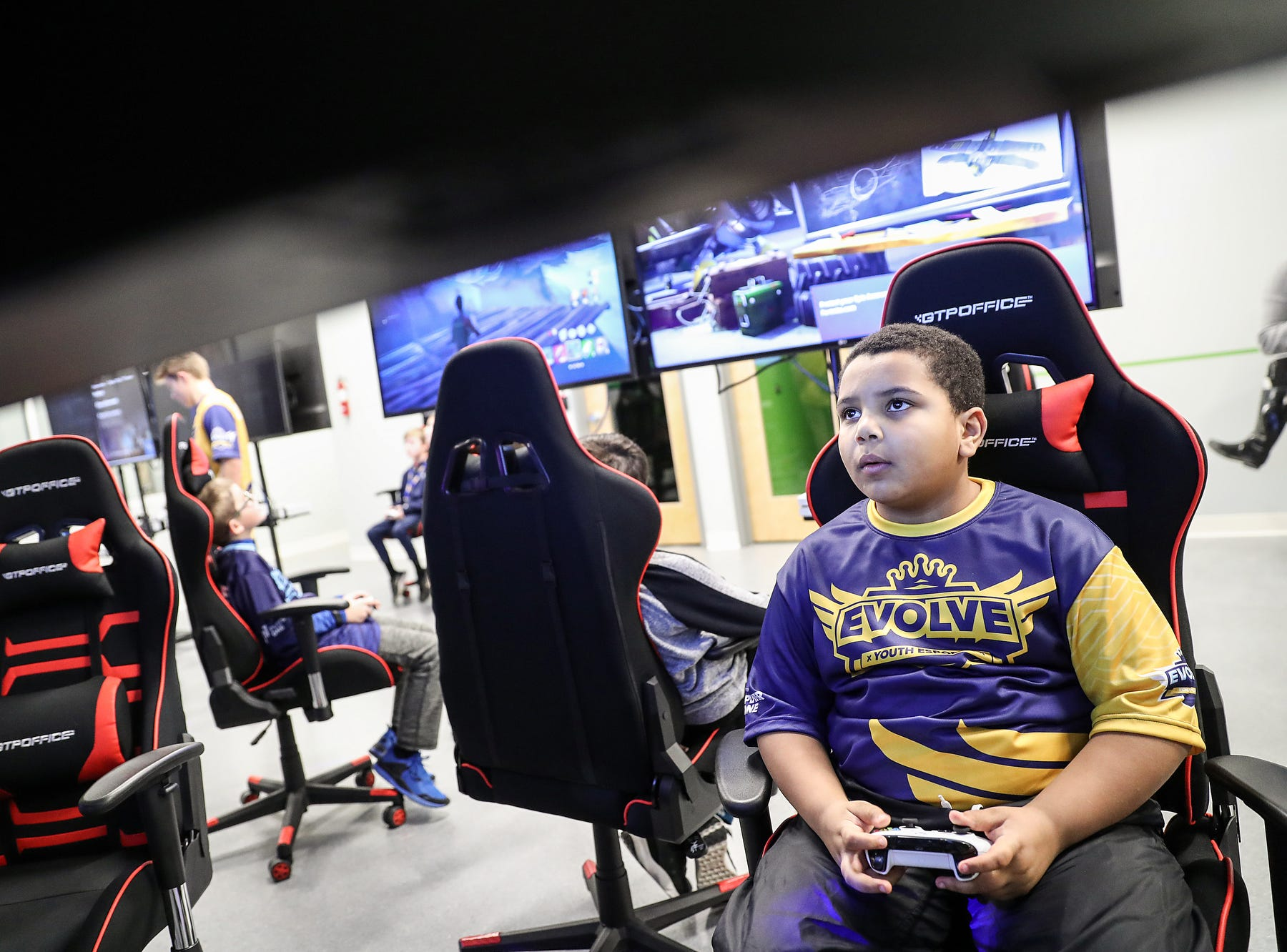 Kaleb Jones, 9, competes in a video game during an Evolve Youth Sports practice at the Player One arena in Carmel, Ind., Thursday, Jan. 24, 2019. Scott Wise, original founder of Scotty's Brewhouse, has partnered with Player One Esports for his next venture, a video game sports league that has attracted around 200 kids so far.