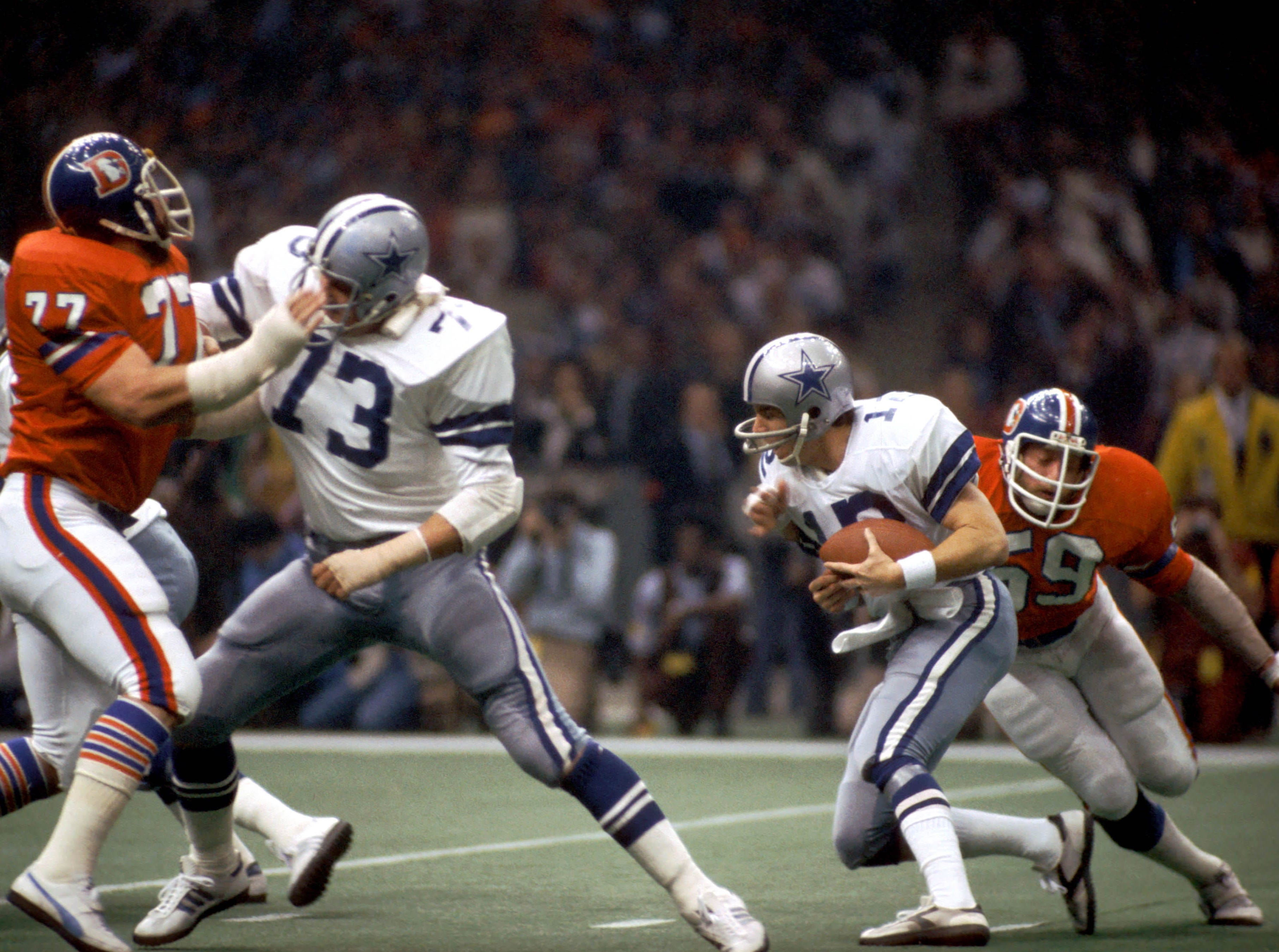 The Dallas Cowboys were another powerhouse in the 70s. They finished the decade with 105 regular season wins, the most for any team, and won two out of five Super Bowl appearances (VI and XII). (pictured: Jan 15, 1978; New Orleans, USA; Denver Broncos linebacker (59) Joe Rizzo sacks Dallas Cowboys quarterback (12) Roger Staubach during Super Bowl XII at the Superdome. The Cowboys defeated the Broncos 27-10.)