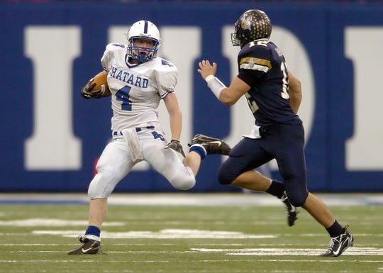 Bishop Chatard running back Joe Holland looks to avoid the tackle Norwell's Chandler Harnish (12) in the Class 3A State Football Championship game.