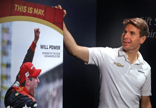 IndyCar driver and Indy 500's 2018 winner Will Power takes a look at the 2019 Indy 500 ticket that was unveiled at Rhythm! Discovery Center, Monday, Jan. 28, 2019.