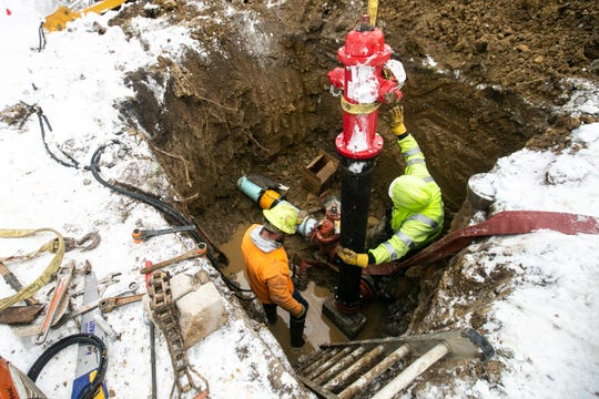 Iowa City Water Distribution employees Eric Gringer, left, and Michael Willis work to fix a broken fire hydrant on Monday, Jan. 28, 2019, along Morningside Drive on the corner of Court Street in Iowa City, Iowa. Residents are notified beforehand when water will be disconnected prior to scheduled repairs occurring.