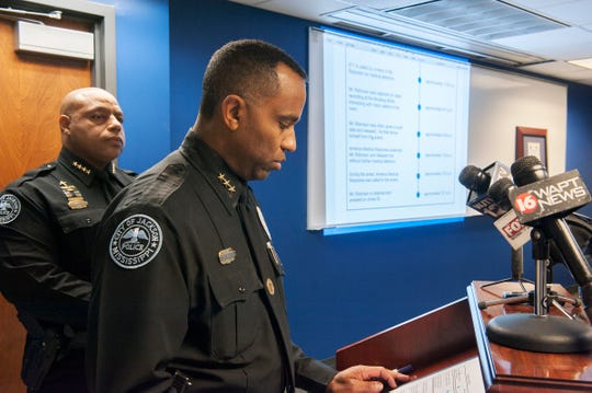 During a Monday, Jan 28, 2019, news conference at Jackson Police headquarters, Chief James Davis, from left, listens as Asst. Chief Ricky Robinson reads the timeline of the last days of George Robinson's life. George Robinson's death has been ruled a homicide.