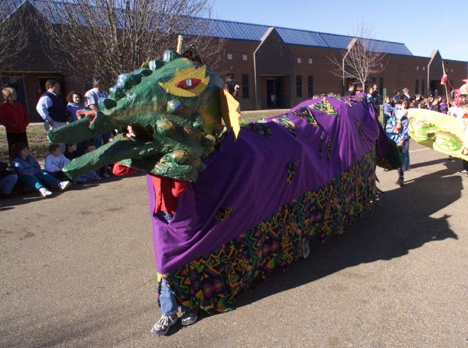 Students in the fifth grade classes at Madison Avenue Elementary School present a parade of dragons to celebrate the Chinese New year Friday morning. The lunar holiday is marked on the second full moon of the new calendar year. Several classes dressed in traditional Chinese attire and marched behind dragons to the delight of other students at the school.