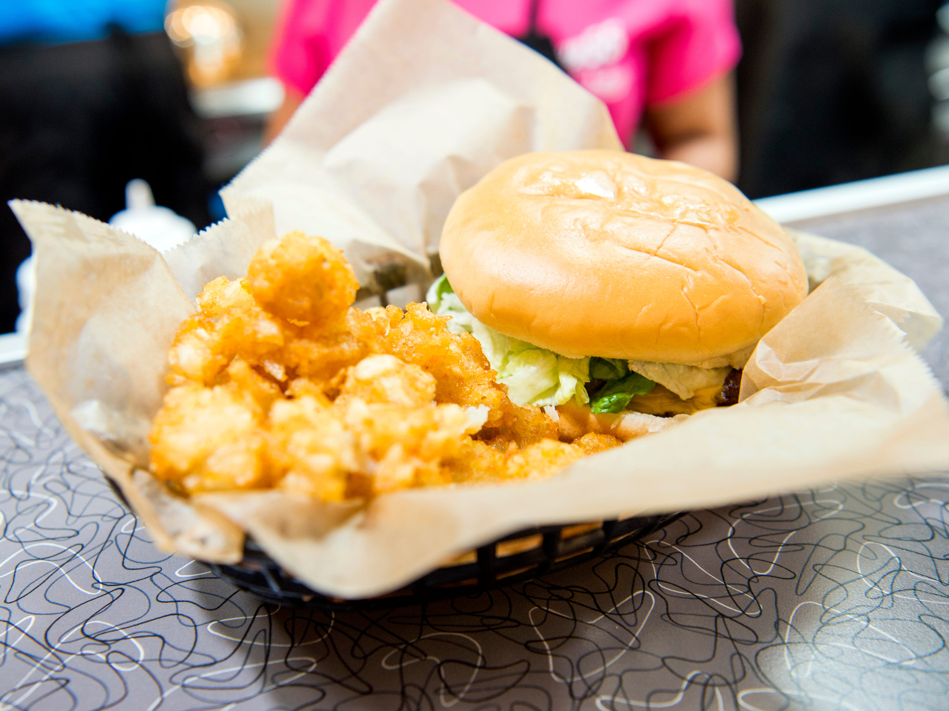 A cheeseburger and tater tots meal at the new Hwy. 55 Burgers, Shakes & Fries at West Town Mall in Knoxville on Monday, January 28, 2019.