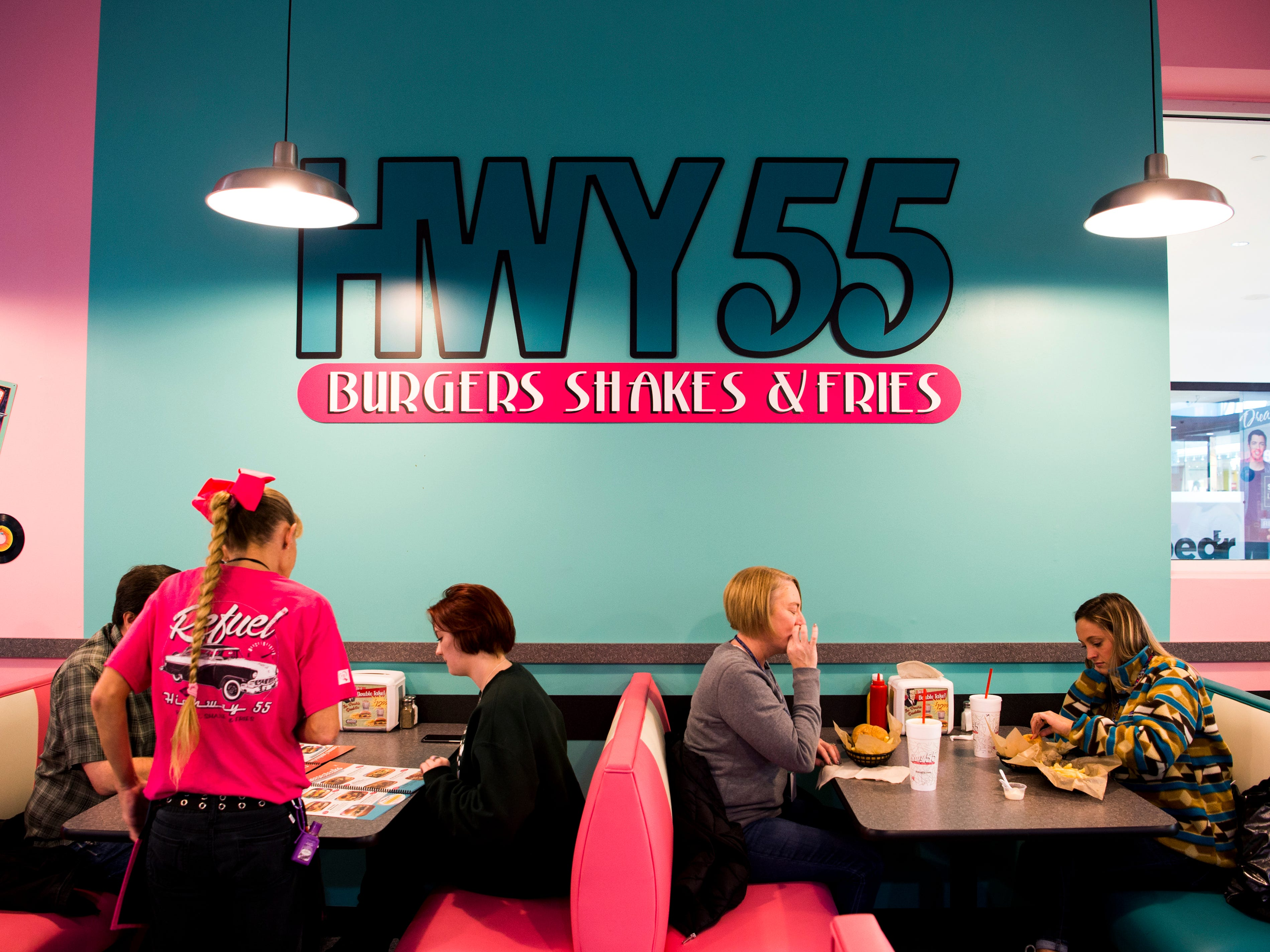 Customers eat lunch at the new Hwy 55 Burgers, Shakes & Fries at West Town Mall in Knoxville on Monday, Jan. 28, 2019.