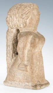 "Miss Lucy, a 15 ½"" carved limestone sculpture of a woman carrying a Bible and a handbag, by William Edmondson ), sold for $324,000 at the Jan. 26 Case Antiques Auction in Knoxville."
