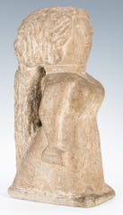 """Miss Lucy, a 15 ½"""" carved limestone sculpture of a woman carrying a Bible and a handbag, by William Edmondson ), sold for $324,000 at the Jan. 26 Case Antiques Auction in Knoxville."""
