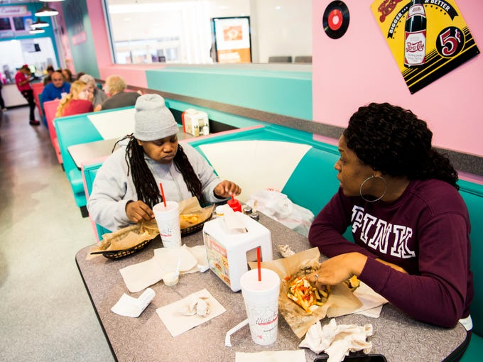 Stenika Williams, right, and Jackie Williams, left, eat lunch at the new Hwy. 55 Burgers, Shakes & Fries at West Town Mall in Knoxville on Monday, January 28, 2019.