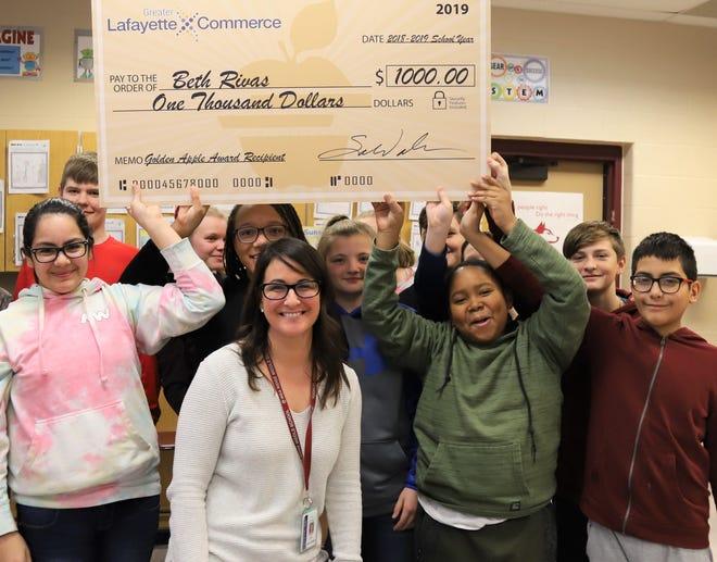 Beth Rivas, science teacher at Wea Ridge Middle School, was among the five Tippecanoe School Corporation teachers who won the Golden Apple award and $1,000.