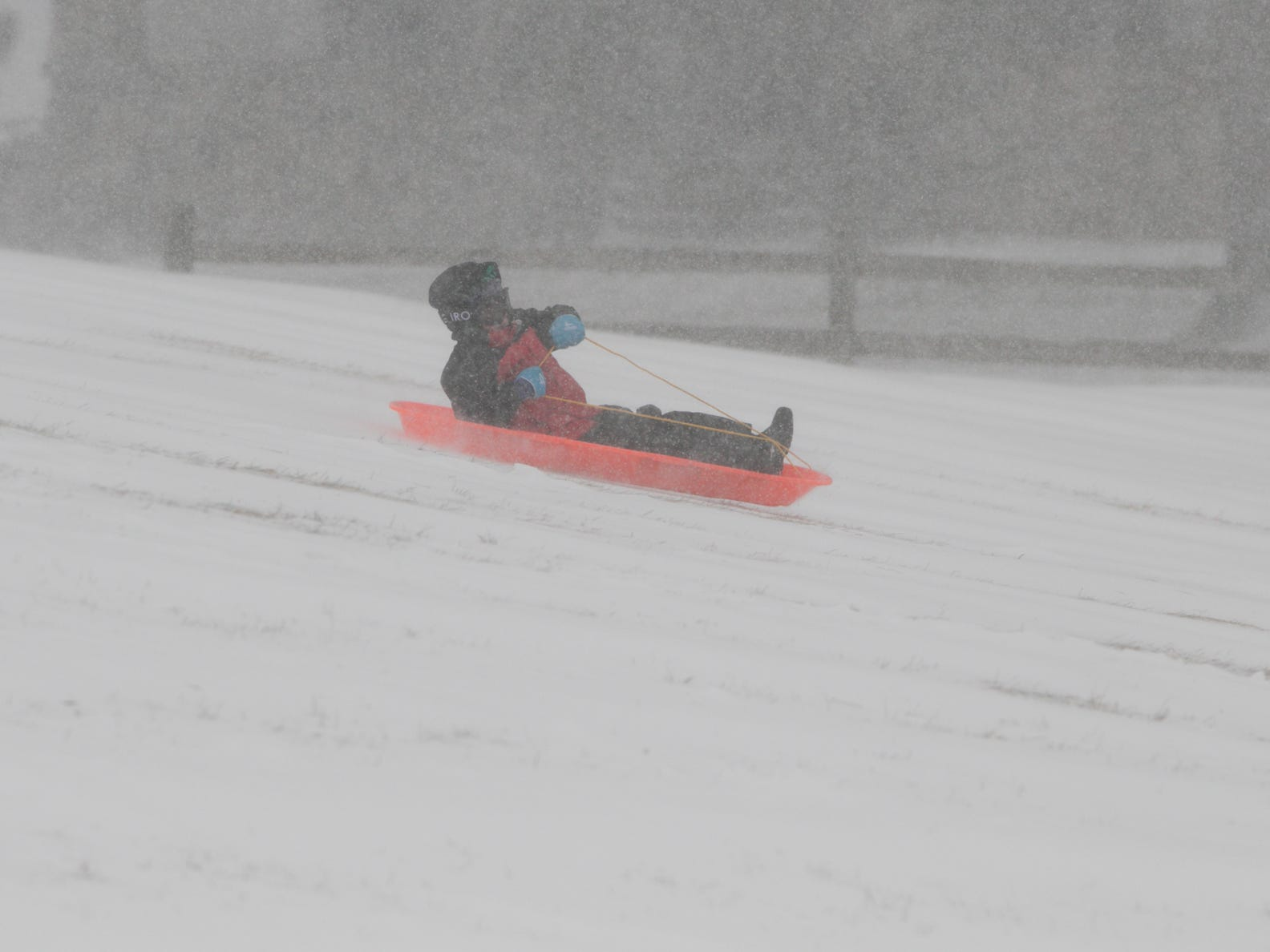 5-year-old Jack Martin slides down the sledding hill at Genoa Township Park in the middle of the snowstorm Monday, Jan. 28, 2019. He and his twin brother Luke and dad Matthew of Howell made the best of the cold weather and snow.
