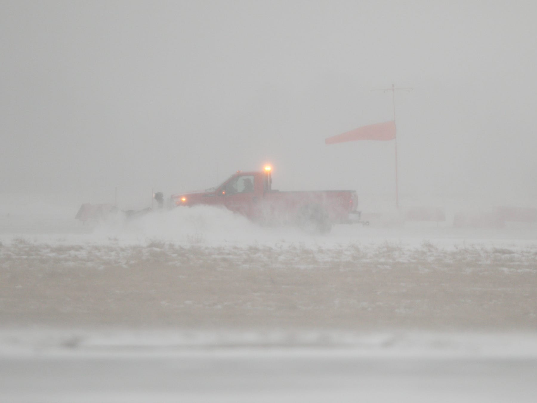 A snow plow clears a runway at the Livingston County Spencer J. Hardy Airport as snow continues to fall Monday morning, Jan. 28, 2019.
