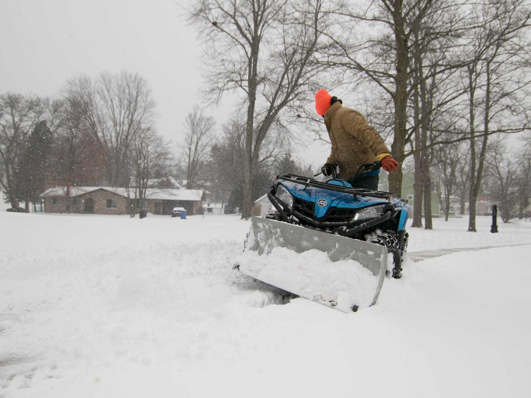 A member of the CBA Outdoors Landscaping Services plows the driveway at the McPherson Mansion, an office building in downtown Howell Monday, Jan. 28, 2019.